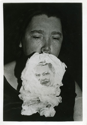 Photograph of medium Mrs. Marshall with teleplasmic manifestation of Sir Arthur Conan Doyle attached to her face
