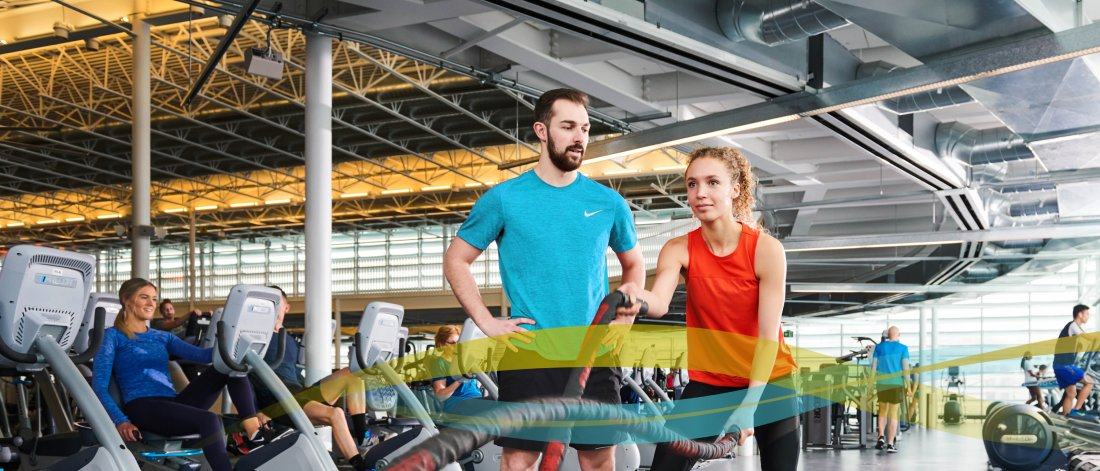 Two people exercising at the University of Manitoba Active Living Centre