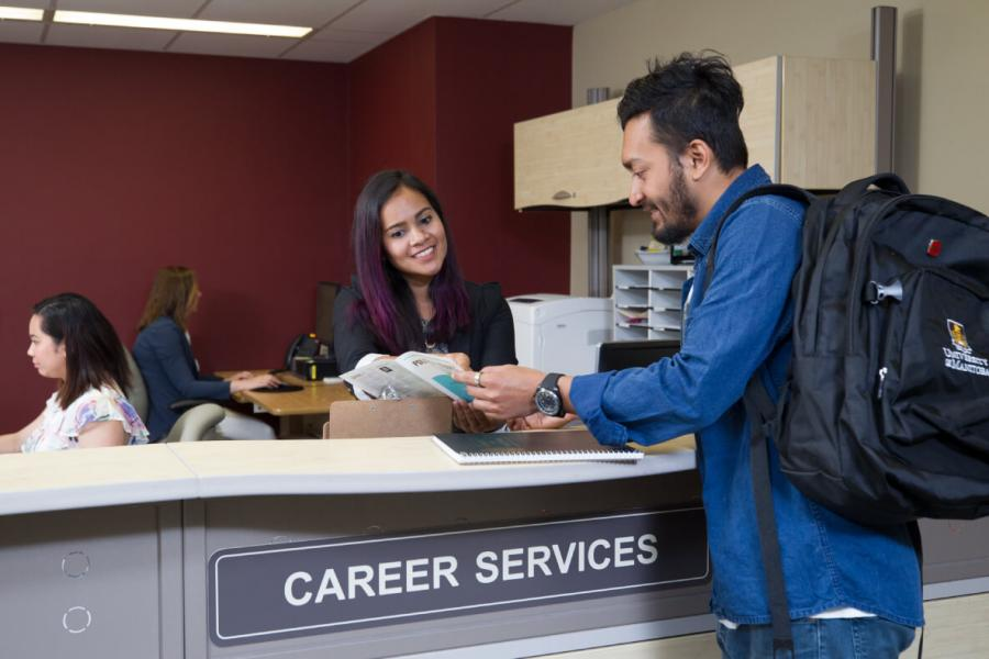 student at career service office getting support