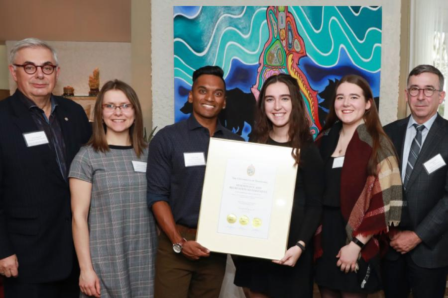 A group of University of Manitoba students holding a certificate