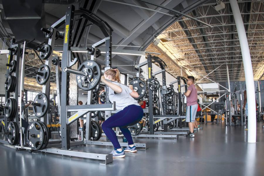 Woman lifting weights in the Active Living Centre