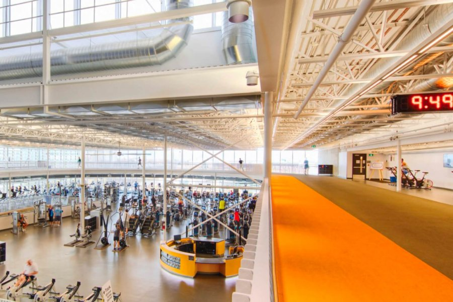 A panoramic interior view of the Active Living Centre indoor running track and the strength and conditioning facilities.
