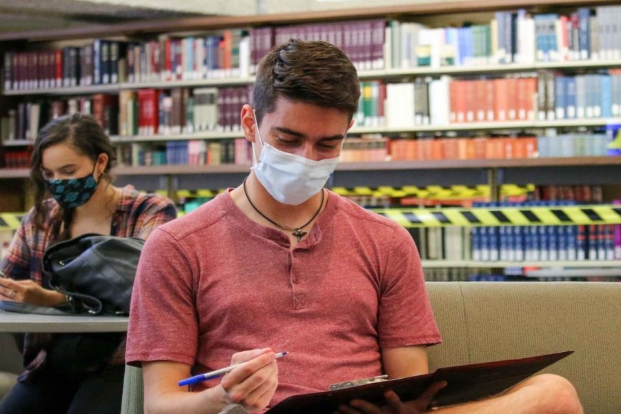 Student in mask in library at University of Manitoba