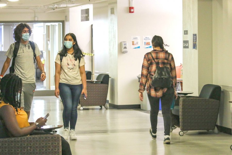 Students wearing masks walking in hallways